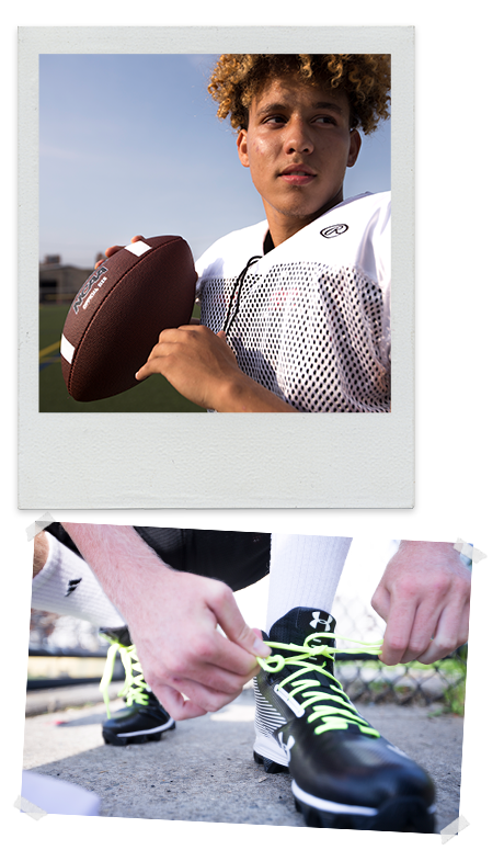 boy in white mesh football jersey gets ready to throw a pass and boy in blue shirt catches the football