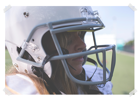 girl in white football helmet with gray facemask