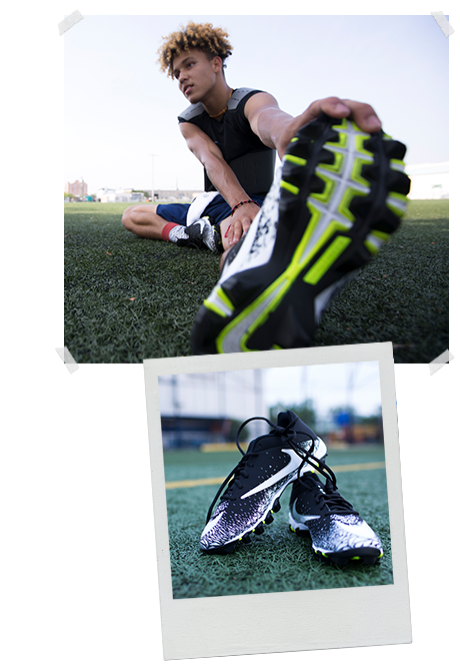 boy in black nike football cleats stretches leg on the football field